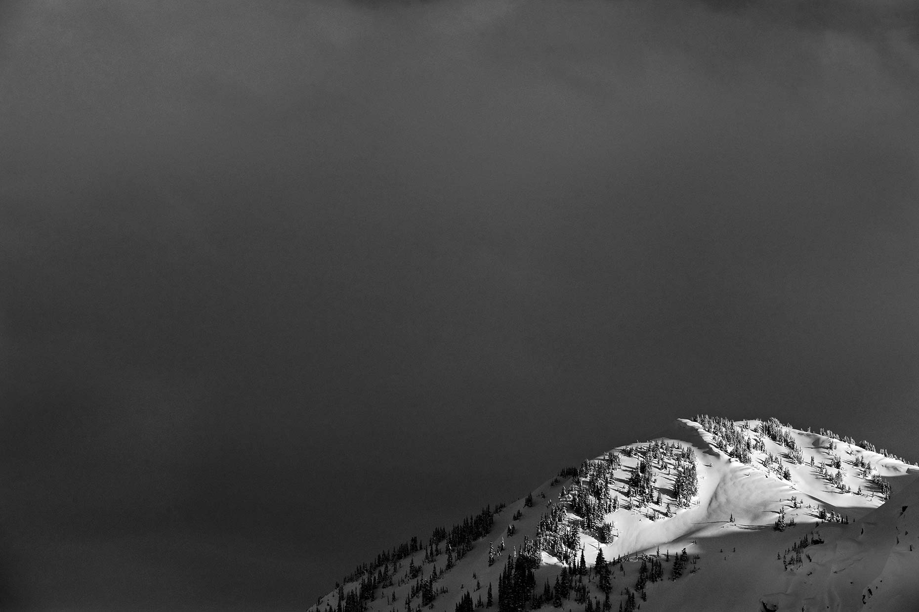 Sliver-of-Light-on-Lone-Peak,-Rogers-Pass,-BC